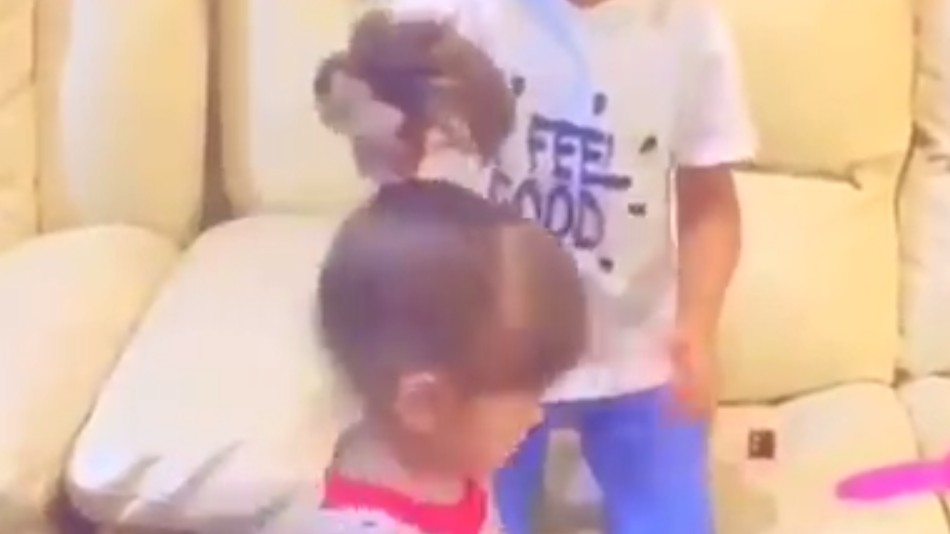 Watch: Little Boy Does His Little Sister's Hair Like a Pro