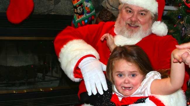 psychologists believe that he frightens young children because of his ability to judge them as naughty or nice - Santa Claus Kids