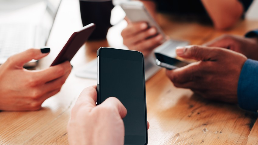 Image result for images of checking  mobile phones